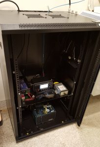 Rack shelf with radio and interface inside a cabinet